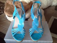 Brand New Women's blue wedge heels size 6