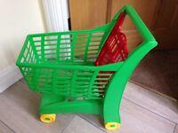 Children's green shopping trolley toy
