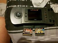 Atari Lynx handheld + 2 games - snes nes nintendo sega