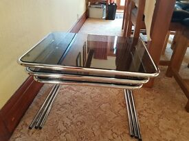 3 stacking coffee tables smoked glass and metal legs circa 1970's