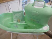 Winnie the Pooh baby bath with stand and accessories