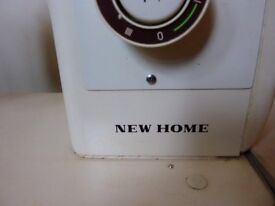 New Home vintage old collectible useable sewing machine in case