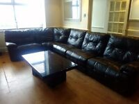 Large black leather recliner corner sofa