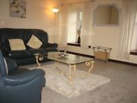 Spacious 1 bed furnished flat in quiet residential location with private parking.