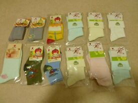 BRAND NEW & UNOPENED - BOX OF 12 PAIRS OF INFANT SOCKS OF VARIOUS COLOURS & PATTERNS. AGES 1 TO 3.