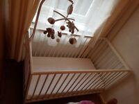 Preused Cot in nice condition, mobile not included.