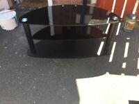 A black glass tv stand.