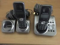 Panasonic wireless landline phones with built in answer machine. 2 handsets, 3 base units (1spare)