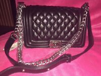 Brand new Chanel Classic Le boy handbag in black with metal chain