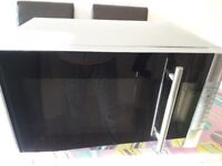 Second hand microwave with grill. Good condition.