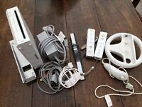 Nintendo wii + 2 controllers and wheel