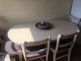 Cream and grey wood foldable dining table and 4 cushioned seats for sale