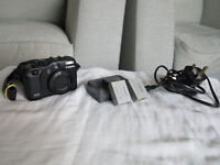 Canon PowerShot G12 with damaged lens unit