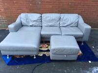 Grey leather corner sofa with storage footstool