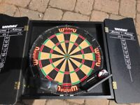 Dartboard never used with surround for wall and 2 sets of unused professional darts.