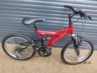 CHILDS SOLAR SUSPENSION BIKE IN EXCELLENT USED CONDITION.. (SUIT APPROX. AGE. 6 / 7+)..