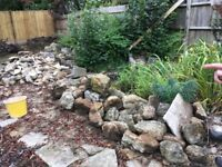 Purbeck stone mix of large boulders and flat slabs suitable for low walling