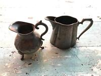 Two antique pewter jugs