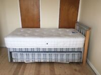 Single bed with pull out camp bed