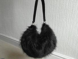 Black fluffy handbag by Dents
