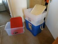 8 large plastic storage boxes
