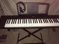 Yamaha keyboard with stool