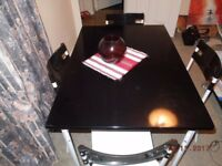 Table and 4 chairs for sale