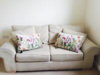 Fantastic cream fabric 2 seater sofa bed for sale.