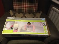 Lindam pink bed guard as new
