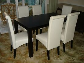 Dark walnut / black wooden dining table and 6 chairs