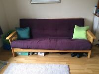 3 seater sofa bed/futon in good condition