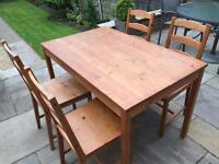 Solid antique pine table and four chairs