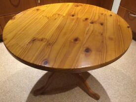 Pine round dining table and four chairs
