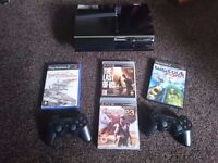 Ps3 plays ps2,1 games,2 pads+4 games
