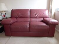 Burgundy leather single chair, two, two seat settees and a large foot stool / pouffe.