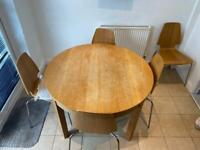 Wooden round dinner table with 5 chairs