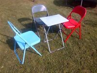 a set of colorful garden table and chairs can deliver