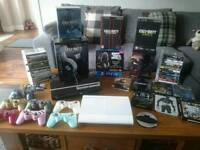 Ultimate and rare PS3 bundle! Consoles, controllers, headsets, games!