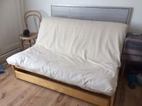Futon sofa bed (double). Solid birch. VGC. With storage drawer & mattress cover (cost of new £900).