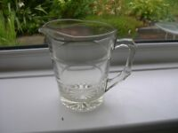 A heavy duty 1 litre capacity clear glass jug.