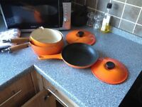 Le crueset pots pans and iron skillet