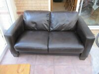Black leather two seater sofa