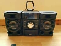 Sony mini HI-FI system MHC-EC69I. Ipod dock, radio, CD player, alarm clock
