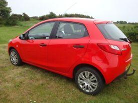 Mazda 2 TS. 1349 cc. 5 door hatchback. 64000 miles. Petrol. Tow bar. Red.
