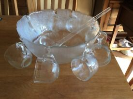 Lovely glass punch bowl and 8 glasses wth plastic ladle