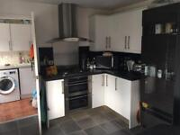 White gloss unit kitchen including oven, hob, extractor and fridge freezer