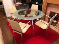 Glass dinner table and 4 chairs in good condition