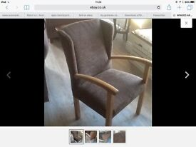 Upright winged armchair newly upholstered with light oak frame