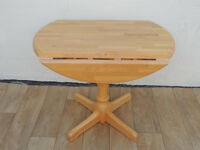 Compact small wooden dining table with lef sides (Delivery possible)