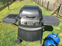 Gas bbq and full tank of gas. 2 burner and side burner